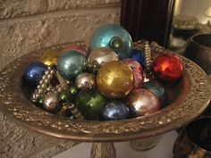 want to eventually have my christmas tree covered from bottom to top in mercury ornaments....for now they are a gorgeous vase filler during for a christmas decoration
