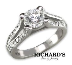 Round-cut Diamond Engagement Ring with round-cut diamonds on the sides