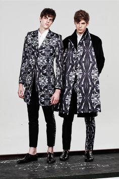"""SEAN SUEN insisted on returning to the origin this season, searching for a breakthrough through its attention to detail and cut. The printed pattern of little figures is a metaphor for """"Rebirth"""", representing the designer's yearning towards beauty... »"""