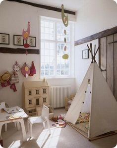 White bright airy childrens bedroom playroom tent wigwam table chair carpet dolls house colourful chicken mobiles real home L etc 04/2007 no...