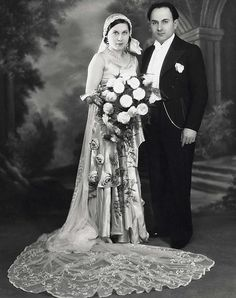 A new book called Vintage Glamour In London's East End features the pictures of studio photographer Boris Bennett. Bennett and Julia Vines had their wedding photo taken by a member of Bennett's staff after their wedding on 4 June, 1930 at the New Road Synagogue in Whitechapel. Julia's dress was made of white and pink satin, with a long train of Brussels lace and was designed by Bennett himself