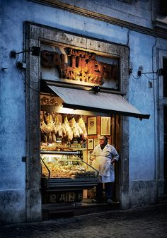 Salumeria in Bologna, Italy - Traditionally meat and sausages (salsiccia) are sold at the butcher and other meat products are sold at the salumeria. In more recent times, salumerie often sell various products including cheeses, eggs, pastas and ready-to-eat antipasti.