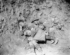 Battle of the Scarpe. Capture of the Greenland Hill by the 51st Division. Two stretcher bearers take advantage of a lull to sleep a little...  Stretcher-bearers of the 6th Battalion, Seaforth Highlanders asleep. Near Roeux, 29 August 1918