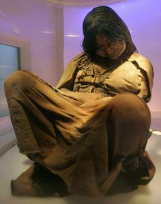 """Photo of the """"Llullaillaco Maiden"""", a 15 year old girl sacrificed during the Inca Empire for both purposes of religious rite and social control. She was chosen a year prior to her death, fed a ritualistic diet for an approximate twelve months to make her gain weight, then was drugged and left on the shrine at Volcano Llullaillaco, where she was left to die of exposure. For five hundred years, her body had been preserved at 82 ft. She is considered to be the best preserved Andean mummy…"""