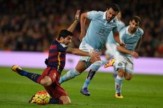 Barcelona's Uruguayan forward Luis Suarez (L) vies with Celta Vigo's Argentinian defender Gustavo Cabral during the Spanish league football match FC Barcelona vs RC Celta de Vigo at the Camp Nou stadium in Barcelona on February 14, 2016
