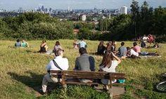 Londoners relax on Parliament Hill, Hampstead Heath.
