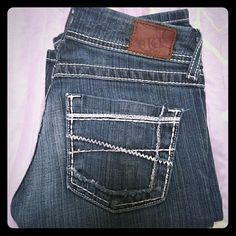 BKE Stella slim boot cut These jeans are low rise worn but in good condition a few frays on the pockets but still awesome I would keep them but just too small! Size 25 with a 33.5 in seam BKE Jeans Boot Cut