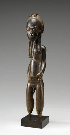 Africa | Male figure from the Baule people of Ivory Coast | Wood; fine dark-brown patina overall with some ancient surface losses