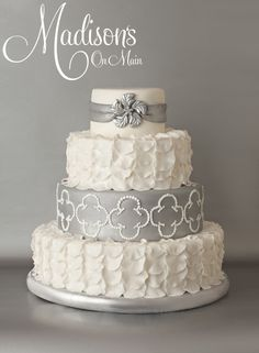 I was asked to create a cake for Cake Central Magazine's winter edition.  I wanted it to be something a bride would want to actually use for their wedding day.  I cut hundreds of fondant rose petals and used them for the 2nd and bottom tier.  The top tier has a modern day snowflake brooch make from fondant.