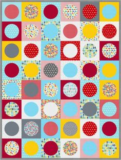 """Seeing Spots"" quilt designed by Ann Kelle. Features Kona Cotton, Remix, and Urban Zoologie Minis. Primary colorstory. FREE pattern."