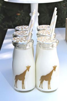 12 metallic gold vinyl giraffe decals. Use on bottles or plates as seen at our golden safari party