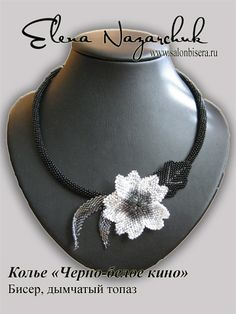 pretty flower/leaf necklace.. non-traditional color scheme for this type of work... me likey