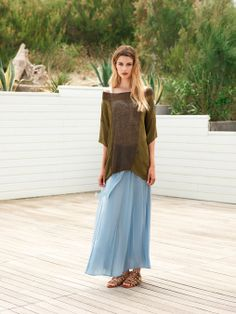 flowing blue skirt and see-through loosely-knit olive green top. Très Mediterranean.