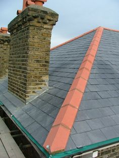 New natural slate roof with universal hips and ridge and new lead flashings and back gutter around chimney stacks call scott on 07886113418 call billy on 07957949616