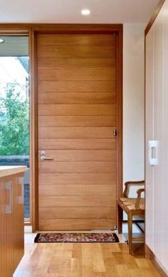 Paneled interior or exterior ETO Door. Gorgeous wood designed just for your home. & A rich mahogany interior striped door from ETO Doors just in time ... pezcame.com