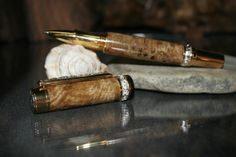 The Monroe Series Rollerball Pen finished in a beautiful Amboyna from Australia and trimmed in Gold & Sterling Silver. Luxurious and only $120.
