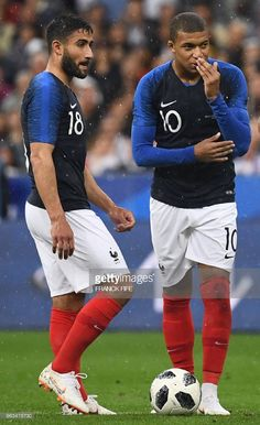 France's forward Nabil Fekir (L) speaks with France's forward Kylian Mbappe during the friendly football match between France and Ireland at the Stade de France stadium, in Saint-Denis, on the outskirts of Paris, on May 28, 2018.