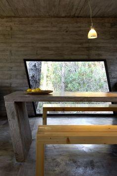 Dining Room Concrete House ByBAK ArchitectsPhotography ByDaniela Mac Adden