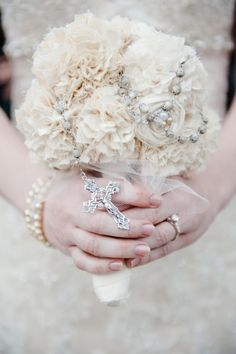 All white wedding bouquet with rosary.....Awesome idea