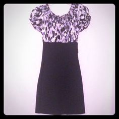 Animal print work dress Looks like a top and a pencil skirt but it's a one piece dress. PERFECT for work. Dresses Midi