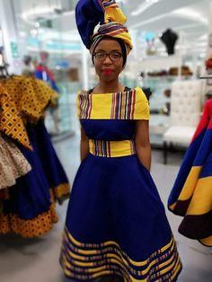 Mokgadi Venda off shoulder blue twill - P&H Menlyn Mall African Party Dresses, African Bridesmaid Dresses, Long African Dresses, African Fashion Dresses, African Attire, Xhosa Attire, Venda Traditional Attire, Sepedi Traditional Dresses, South African Traditional Dresses