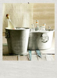 Wine Bucket. Party Bucket. Chill, stow and serve beverages in style with this sleek collection of buckets crafted for entertaining. The sturdy wine and party buckets are made of hammered aluminum with handles for carrying.