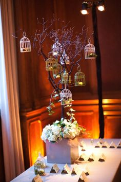 branch centerpiece with birdcages...makes me think of Easter second.