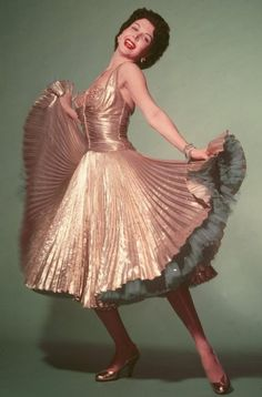 Ann Miller in The Thrill of Brazil (1946) i  bet the spin factor on this dress is way up there:)