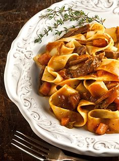 Leah Eskin's  Pot Roast ! .... this is a wonderful pasta dish with a hearty rich Beefy tomato gravy with pot roast sredded and mixed in to form one of the best dishes out there.... you'll love this recipe so much it will be passed down for many generations.