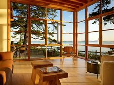 Windows, wood, and water...now that's what I'm talkin' 'bout...although I'd have different furniture, this room is stunning.