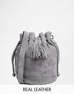 83d221f49d96 Warehouse Suede Drawstring Duffle Bag with Tassel at asos.com
