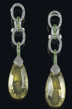 A pair of brilliant and quartz ear pendants,  white gold 585, brilliants total weight 0,33 ct, green garnets, lemon citrines, 8 g, with studs