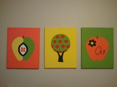 Apple canvases I made for the baby's room with Bekah. Enlarged some of the apples from the quilt in the room.