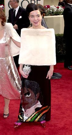 "Bjork at 2001 Golden Globe Awards ceremony. Tribute concerts in, tribute dresses out! And what is that with the ""bad witch at Wizard of Oz"" shoes?"