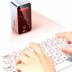 Celluon Magic Cube Virtual Keyboard: The MAGIC CUBE projects a laser onto a flat opaque surface to provide you with a virtual keyboard. You can type on top of the surface of your desk and you can also use the MAGIC CUBE as a mouse. Tech Gadgets, Cool Gadgets, Cheap Gadgets, Amazing Gadgets, Smartphone, Multi Touch, Teacher Tools, Mac Os, Innovation Design
