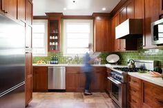 Craftsman Kitchen With Red Wood Cabinets and Green Subway Tile Backsplash