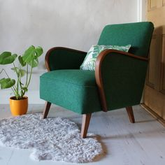 This beautiful club armchair was made in Germany in the 1950s.All of our products are completely unique so you will never find another alike.It has a beautifully curved arms with an open inviting shape. It has been reupholstered in 100% wool woven on the Isle of Bute in Scotland. When I stripped the chair down it revealed matches, cigarettes part of a bullet from a starting pistol with the letters S B W V stamped on it. The fabric is a bright green and dark blue mixture with flecks of…