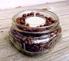 """""""I make these DIY coffee-scented candles by pouring beans (the cheaper, the better) into a small glass jar; just leave a quarter-inch of space on the top, then nestle a vanilla tealight in snugly. It smells like a fresh pot of vanilla coffee — even after the candles are out."""" –Lisa Steele of Fresh Eggs Daily"""