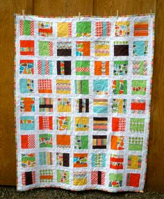 Square blocks bed quilt