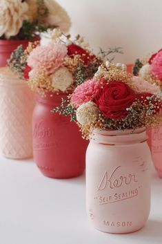 mason jars wedding centerpieces on wedding table rose jars with flowers beach blues