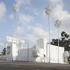 Artist Vincent Lamouroux used a eco-friendly whitewash to completely seal a motel in LA, ossifying it with a new calcium-like coating that formed a ghostly contrast to the blue sky of springtime L.A.. The whitewash, which also covered the surrounding palm trees, was designed to disappear over the course of two weeks...