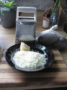 Just like with pre-packaged lettuce, grated cheese costs extra $$$ for the convenience. Grate a large hunk of cheese and keep it in a container in the fridge for easy sprinkling.