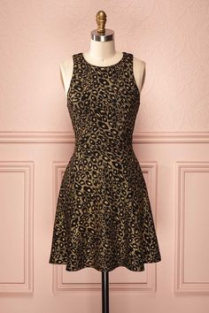 Sienna - Sleeveless black dress with golden leopard print