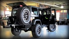 SOLD: 2012 Modified Jeep Wrangler -  Features include: 4 inch zone lift kit, 315/70/17 goodyear duratrac tires, Fuel rims, Black and manchined throttle, Smittybilt xrc front bumper, Smittybilt xrc rear bumper with swing away tire carrier, Smittybilt x20 8 comp winch, Piaa 510 atp lights, Oracle green head light inserts, Custom green decal pkg & Custom green dash kit.