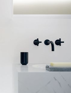 Dornbracht faucet. Classic and bold. really like black or brass against marble...something wall mounted just like this