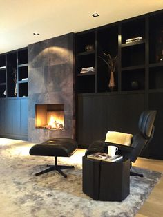 Dark built-in cabinetry, stone fireplace, relaxing nook. Living Tv, Home And Living, Living Room, Living Spaces, Fireplace Wall, Fireplace Design, Masculine Room, Interior And Exterior, Interior Design