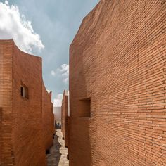 Fluted brick walls frame scalloped views of the sky above this Thai hotel.