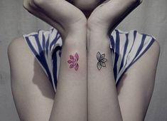Matching lotus flower tattoos on the wrists. Tattoo artist: Wong Pui Yee