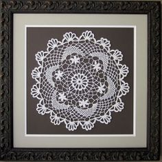 Grandma's doily.  Was in a box where no one could enjoy it, now displayed as a family heirloom.  Grandma had talent!  Framed by Frameworks of Utah.