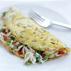 Deviled Crab Omelets | These omelets are extra decadent with the addition of crab meat.